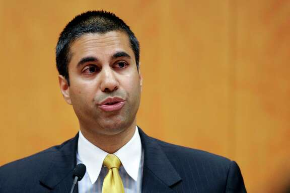 FILE--Federal Communication Commission Commissioner Ajit Pai speaking during a FCC meeting in Washington, Friday, Aug. 9, 2013. President Donald Trump designated Pai as FCC Chairman in 2017. (AP Photo/Susan Walsh)
