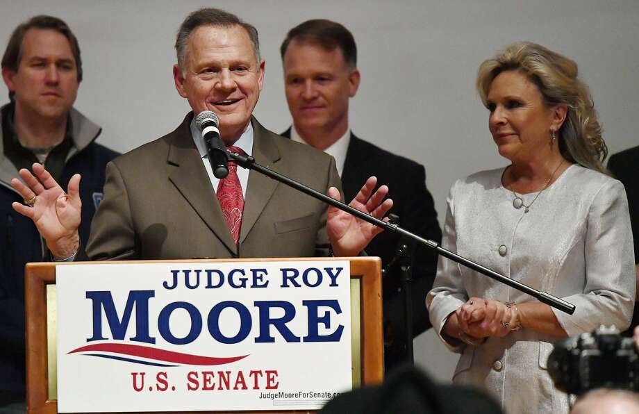U.S. Senate candidate Roy Moore speaks as his wife Kayla Moore, right, listens at the RSA activity center, Tuesday, Dec. 12, 2017, in Montgomery, Ala. Moore did not concede defeat to his Democratic opponent Doug Jones. Photo: Mike Stewart/AP