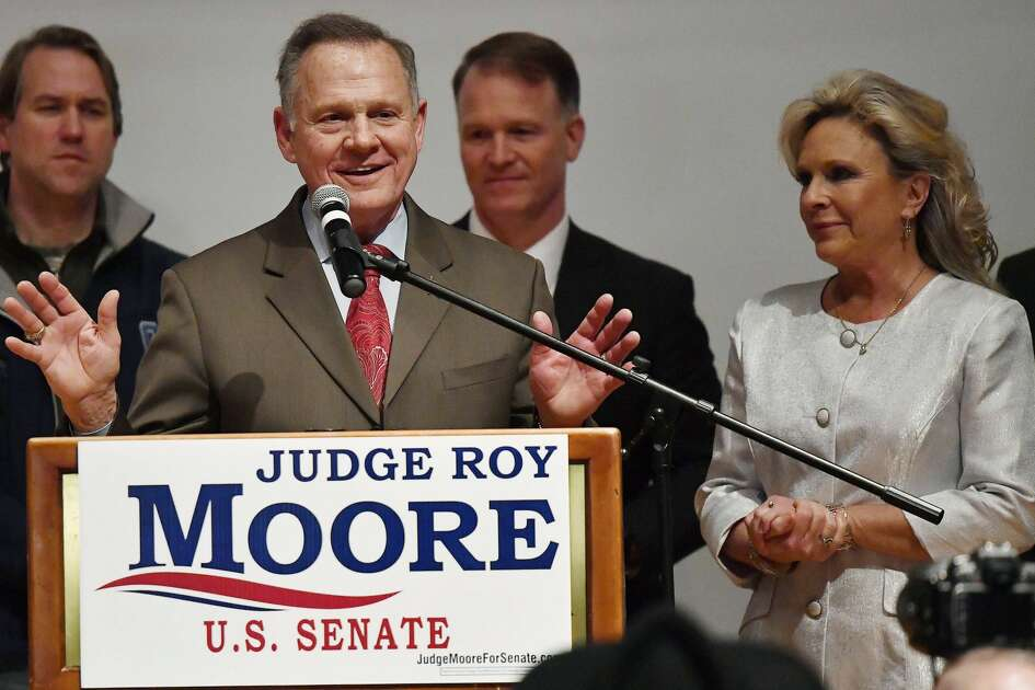 U.S. Senate candidate Roy Moore speaks as his wife Kayla Moore, right, listens at the RSA activity center, Tuesday, Dec. 12, 2017, in Montgomery, Ala. Moore did not concede defeat to his Democratic opponent Doug Jones.