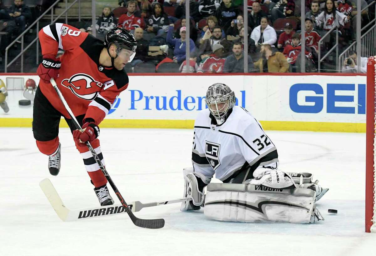 New Jersey Devils left wing Taylor Hall (9) scores a goal past Los Angeles Kings goalie Jonathan Quick (32) during the second period of an NHL hockey game Tuesday, Dec.12, 2017, in Newark, N.J. (AP Photo/Bill Kostroun) ORG XMIT: NJBK104