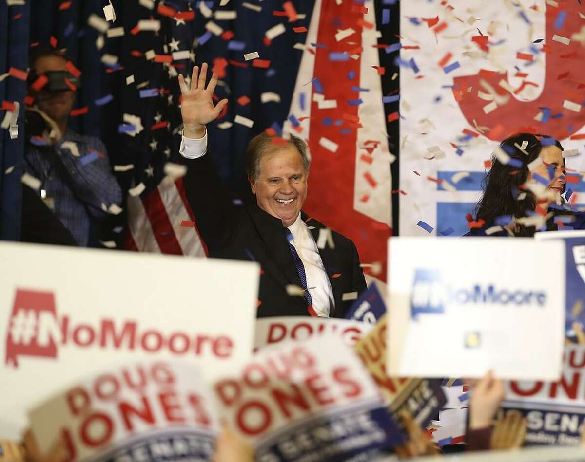 Democratic U.S. Senator elect Doug Jones greets supporters during his election night gathering the Sheraton Hotel on December 12, 2017 in Birmingham, Alabama. Doug Jones defeated his republican challenger Roy Moore to claim Alabama's U.S. Senate seat that was vacated by attorney general Jeff Sessions. (Photo by Justin Sullivan/Getty Images)