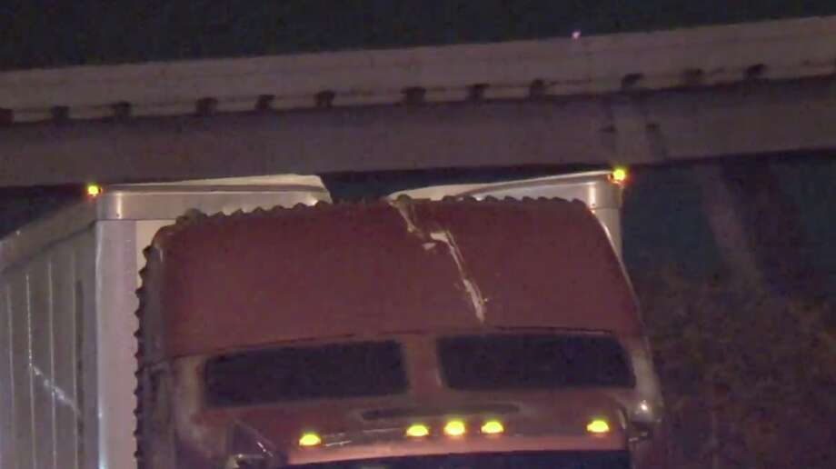 Five semi-trucks hit a steel beam dangling from the Houston Avenue bridge while traveling on I-10 East early Wednesday morning. Photo: Metro Video