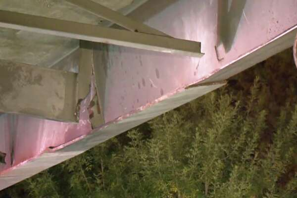 Five semi-trucks hit a steel beam dangling from the Houston Avenue bridge while traveling on I-10 East early Wednesday morning.