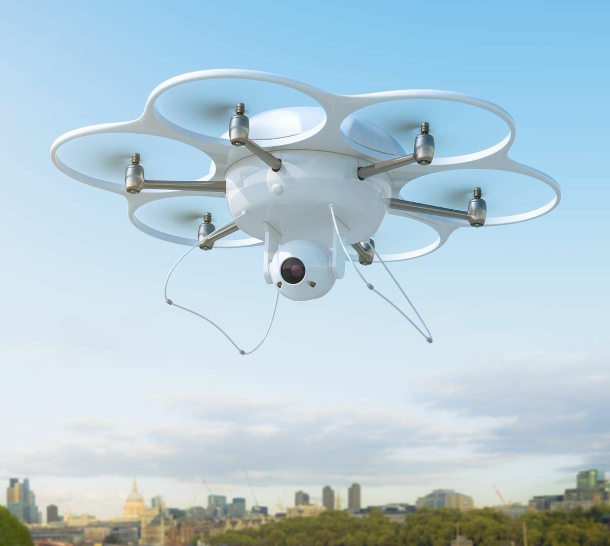 Photo illustration -- A drone (not the one pictured) was seen outside of an Ariana Grande concert and a Sacramento State fundraiser dinner, dropping flyers with anti-media sentiments onto crowds below.