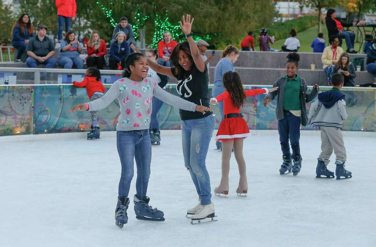 Houston Chronicle's Joy Sewing celebrates winter fun with children at the 2nd annual #YearOfJoy Holiday Ice Skating Party at the ICE at Discovery Green Monday.