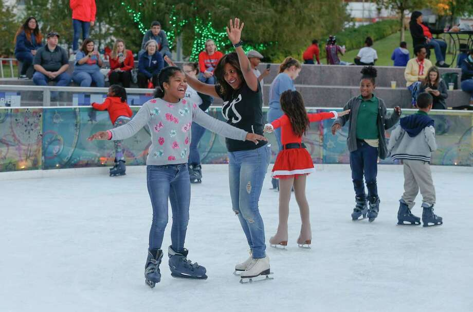 Houston Chronicle's Joy Sewing celebrates winter fun with children at the 2nd annual #YearOfJoy Holiday Ice Skating Party at the ICE at Discovery Green Monday. Photo: Steve Gonzales, Houston Chronicle / © 2017 Houston Chronicle