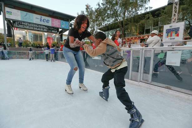 Houston Chronicle's Joy Sewing attempts to teach a child how to keep his balance during the 2nd annual #YearOfJoy Holiday Ice Skating Party at the ICE at Discovery Green Monday, Dec. 11, 2017, in Houston. Joy Sewing is hosting the 2nd annual #YearOfJoy Holiday Ice Skating Party at the ICE at Discovery Green. There will be 75 children from  Third Ward who will participate. 40 of them (from Peck Elementary) will arrive by chartered luxury bus with teacher chaperones. There will also be a party on the deck with food, cake and toys provided by H-E-B.