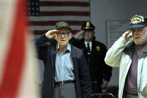 Paul Hulton, 91, left, turned 15 the day the Japanese bombed Pearl Harbor. The VFW Post 1672 and American Legion Ezra Woods Post 31 in New Milford held a ceremony to commemorate the day. At right is John Danish, a navy veteran who served during the Cuban Missile Crisis.