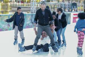 Todd Ramos reacts to skaters losing their balance during the 2nd annual #YearOfJoy Holiday Ice Skating Party at the ICE at Discovery Green Monday, Dec. 11, 2017, in Houston. Joy Sewing is hosting the 2nd annual #YearOfJoy Holiday Ice Skating Party at the ICE at Discovery Green. There will be 75 children from  Third Ward who will participate. 40 of them (from Peck Elementary) will arrive by chartered luxury bus with teacher chaperones. There will also be a party on the deck with food, cake and toys provided by H-E-B.