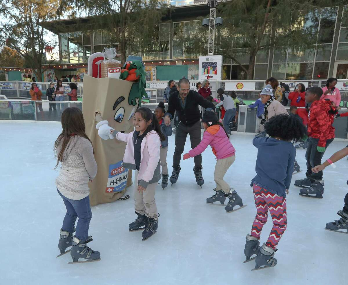 H-E-B provided food and cake for the event, and the supermarket chain's mascot went on the ice to skate with the children.