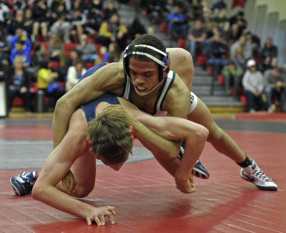New Milford's Mel Ortiz, top, takes on New Fairfield's Alec Opsal during a 120-pound match in the finals of the SWC Championships last season. Ortiz won the match and is back to lead another talented Green Wave team. Photo: H John Voorhees III / Hearst Connecticut Media / The News-Times