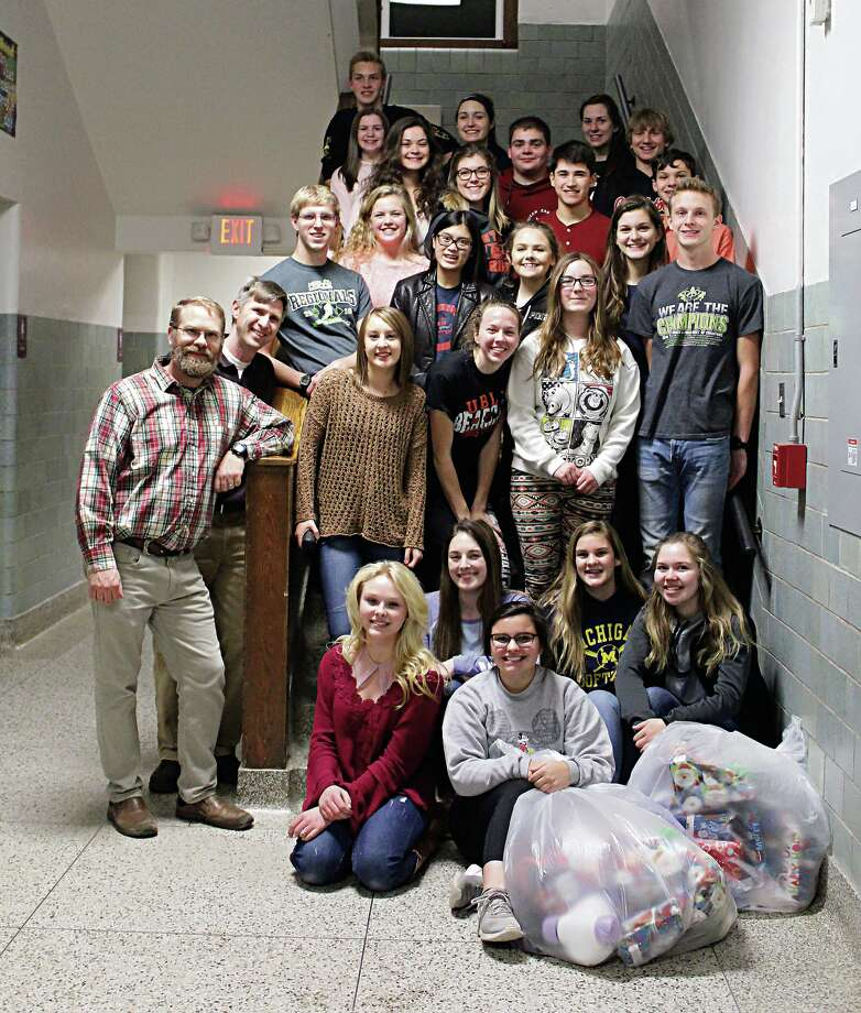 The Ubly Student Council and National Honor Society recently raised money, shopped, and wrapped presents for 13 local families in need for Christmas this year. Together, the students raised more than $1,500. Photo: Submitted Photo