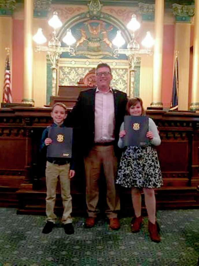 State Rep. Roger Hauck, of Union Township, welcomed fourth-grader Amilia Reed from Coleman Elementary and second-grader Theodore Crain from Vowels Elementary in Mount Pleasant to the Capitol on Dec. 7. Amilia and Theodore were sworn in on the House floor as :Junior Representatives' by Hauck. The students earned this opportunity through their participation in a summer reading contest, where they read a combined 8,475 pages.