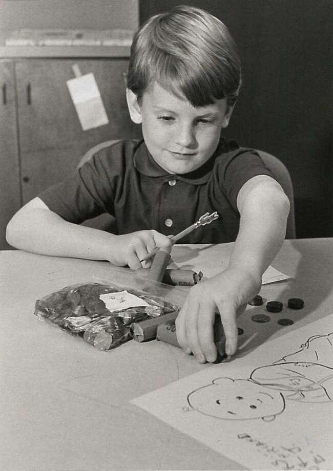 Matthew Matheny, 6, donates to the Empty Stocking Fund in 1984.  Enterprise file photo