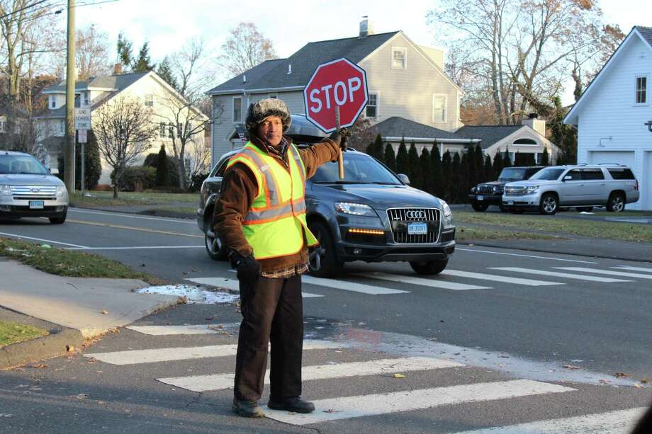 Terry Darden works at various crossings. Here he's working at South Ave. and Gower Rd in New Canaan on Dec. 13, 2017. Photo: Humberto J. Rocha / Hearst Connecticut Media