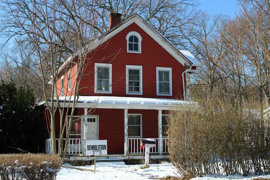 The red house on 74 Forest dates back to the 19th century. Picture taken on Dec. 12, 2017. Photo: Humberto J. Rocha / Hearst Connecticut Media