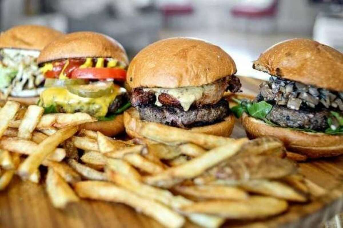 From left, some of the Midland Burger Co.'s creations include the Cabbage Patch Burger, 'Merica Burger, Pork Belly Burger and Umami Burger. (File Photo/Nick King)