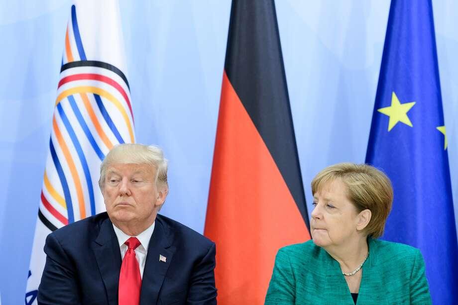 President Trump with German Chancellor Angela Merkel. Photo: Ukas Michael / Getty Images