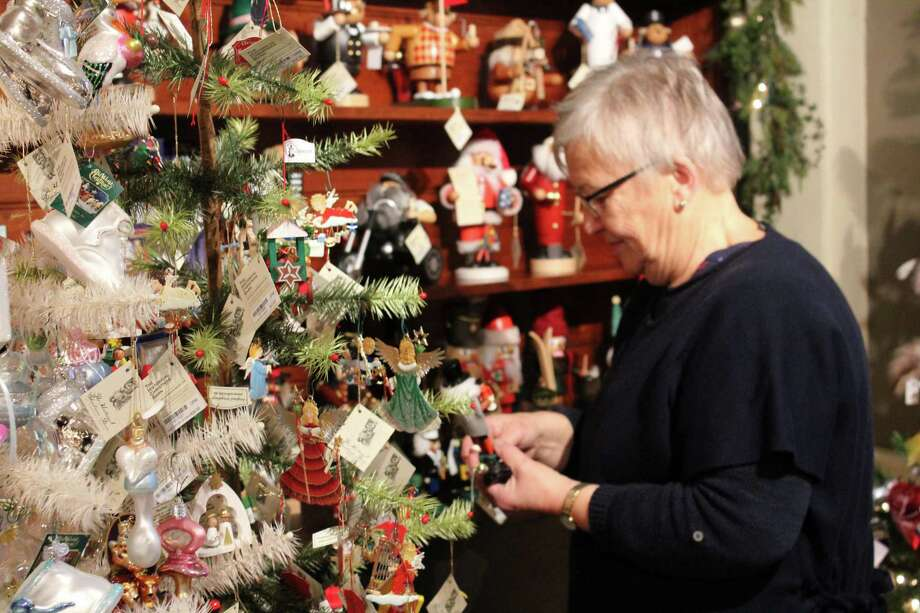 Jo Parry looks through ornaments at the Historical Christmas Barn in Wilton at 150 Danbury Road while visiting her daughter in Weston. Photo: Stephanie Kim / Hearst Connecticut Media