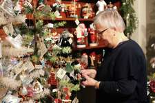 Jo Parry looks through ornaments at the Historical Christmas Barn in Wilton at 150 Danbury Road while visiting her daughter in Weston.