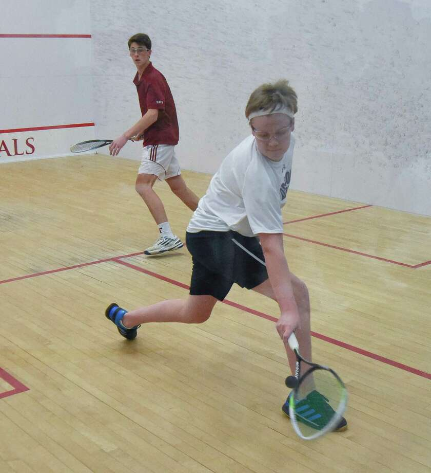 Marshall Bessey, a resident of Darien, and member of the Greens Farms Academy boys squash team, extends for a shot. Photo: Contributed Photo / Darien News contributed