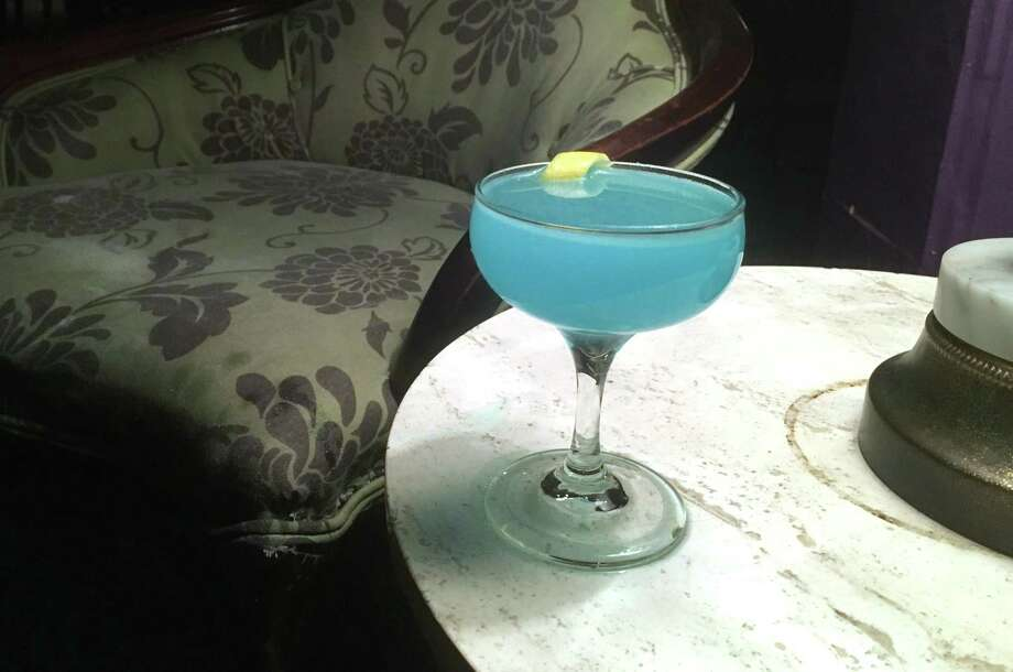 The Fair Blue Guilt ($10) is one of the new cocktails on the menu at The Brooklynite, and features mezcal with blue curacao and arbol chile. Photo: Chuck Blount /San Antonio Express-News