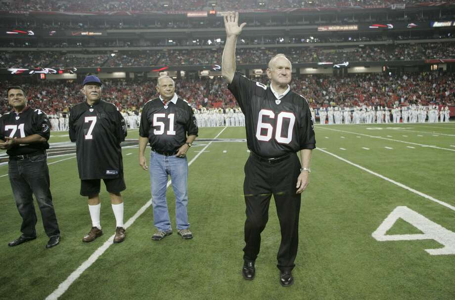 Former Atlanta Falcons Pro Bowler Tommy Nobis (60), the first player ever drafted by the franchise, is introduced along with other members of the 1966 inaugural team during half time of their NFL football game against the Carolina Panthers, Sunday, Sept. 20, 2009, in Atlanta. (AP Photo/John Amis) Photo: John Amis/ASSOCIATED PRESS