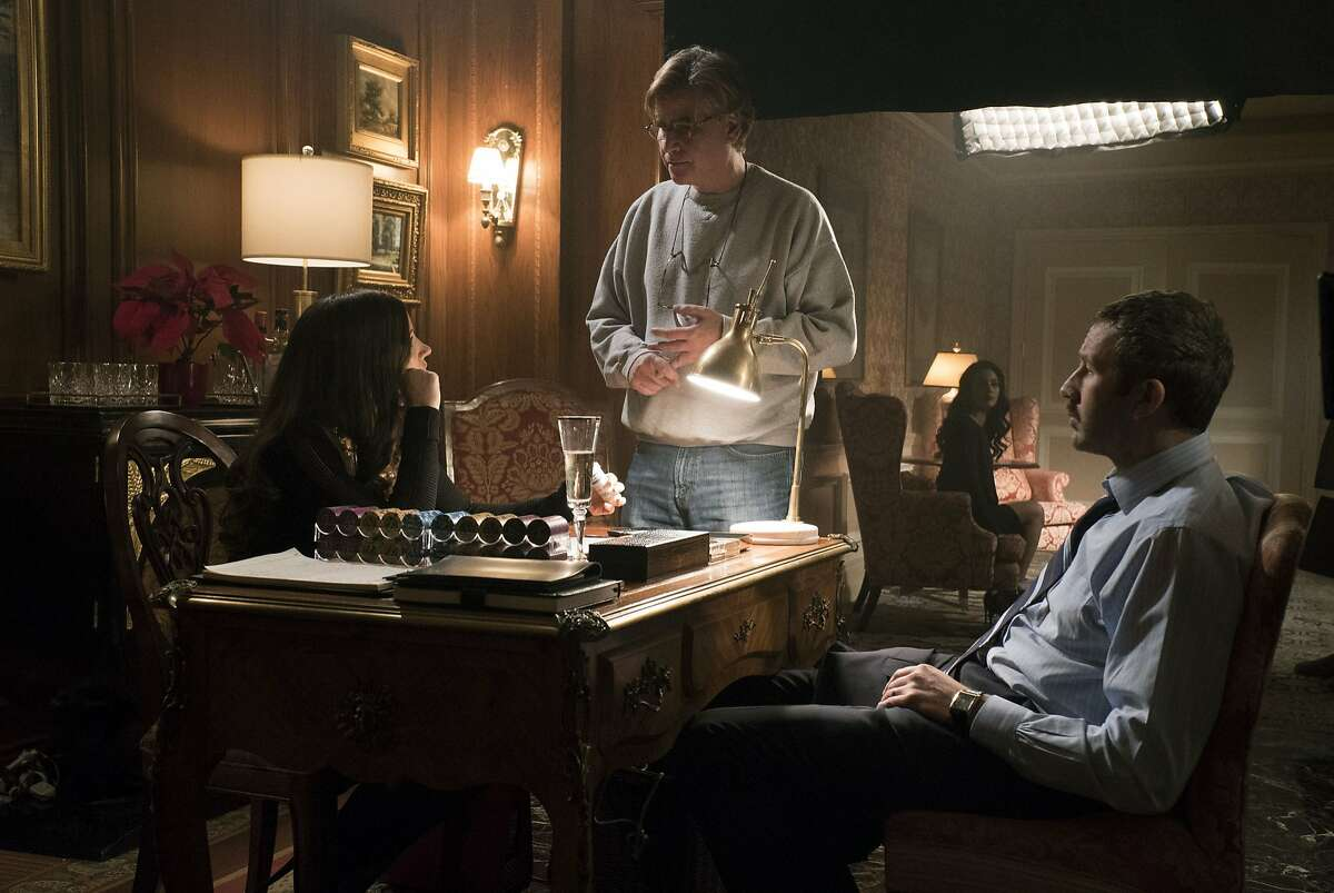 """(l to r): Jessica Chastain, Aaron Sorkin and Chris O'Dowd on the set of the new movie """"Molly's Game,"""" written and directed by Aaron Sorkin"""