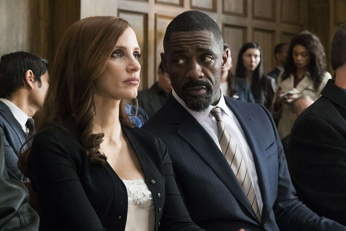 """Jessica Chastain and Idris Elba in the new movie """"Molly's Game,"""" written and directed by Aaron Sorkin"""