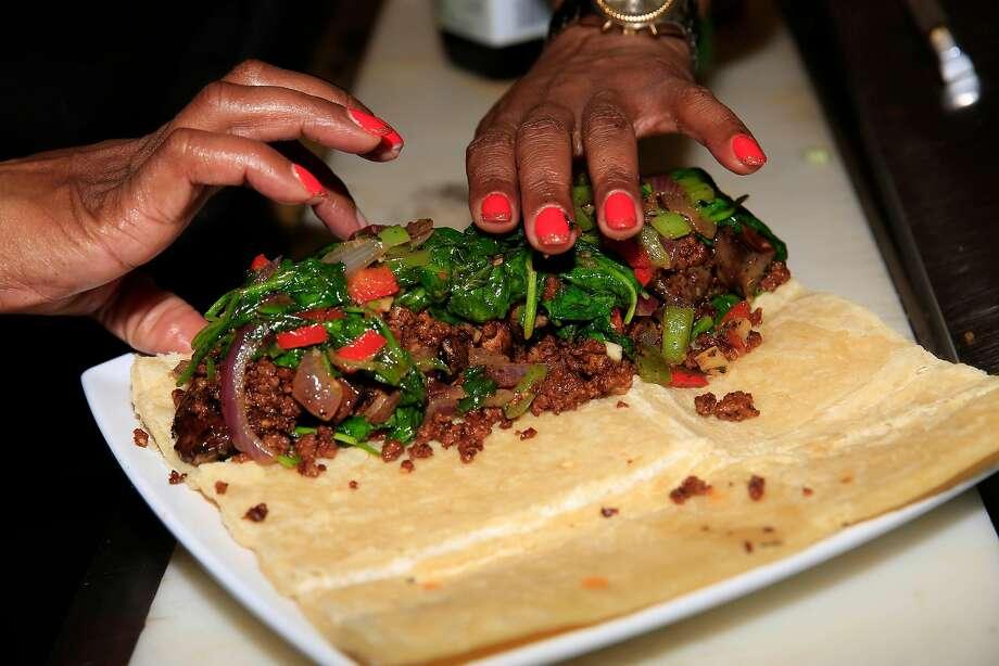 Tamearra Dyson, Souley Vegan chef-owner, rolls up her vegan Wellington. Photo: Lea Suzuki, The Chronicle