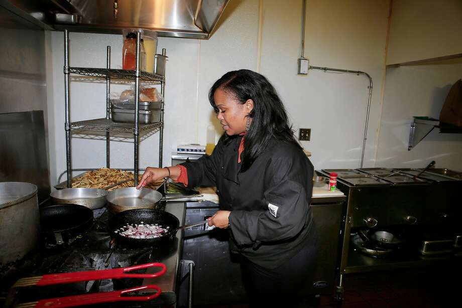 Tamearra Dyson, chef-owner of Souley Vegan, sautes onions as she prepares her vegan Wellington.  Photo: Lea Suzuki, The Chronicle