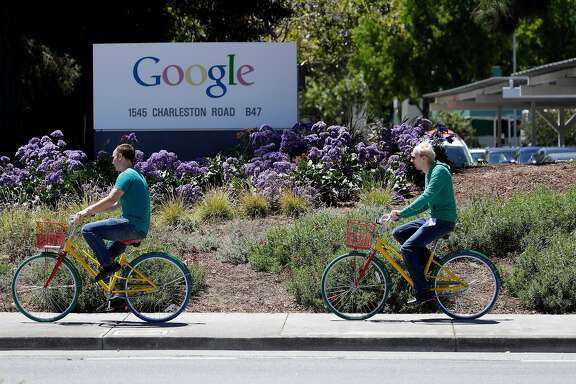 Cyclists ride past a Google sign at the company's headquarters Tuesday, July 19, 2016, in Mountain View, Calif. (AP Photo/Marcio Jose Sanchez)