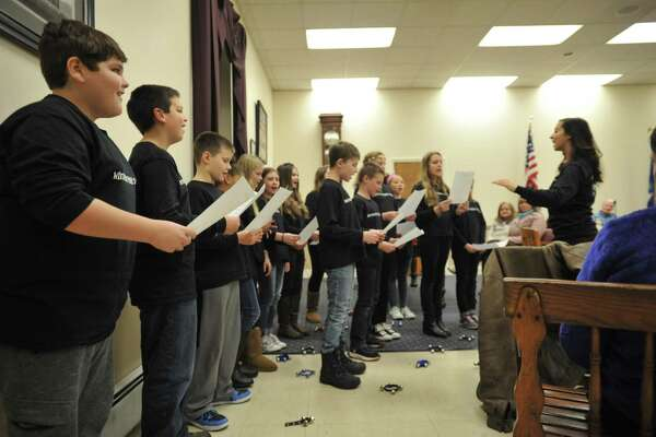 The Pearson Show Choir performs Tuesday at a meeting of the Winsted Board of Education.
