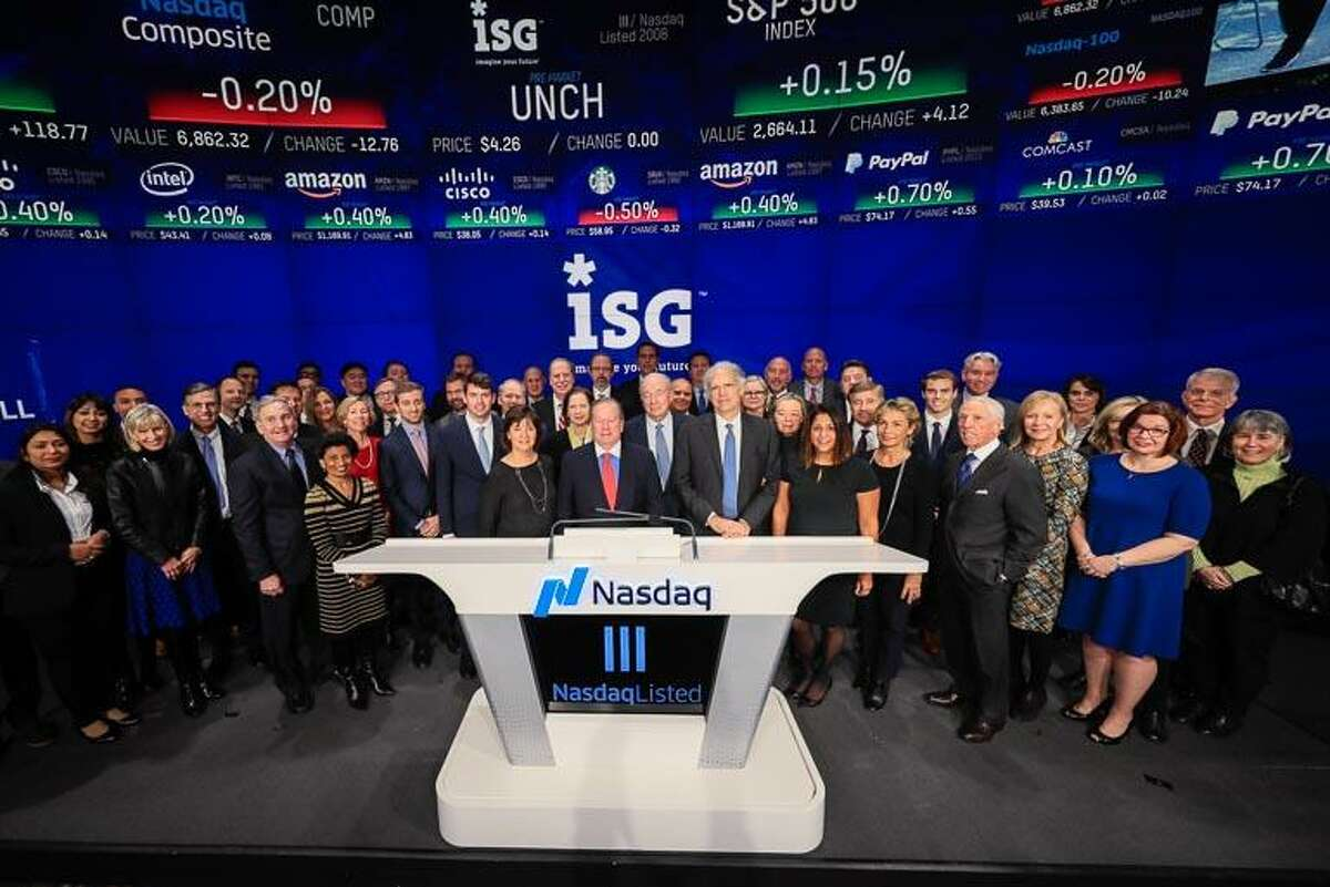 Information Services Group CEO and Chairman Michael Connors, center, rang the Nasdaq stock exchange's opening bell, in New York, N.Y., on Wednesday, Dec. 13, 2017, to mark the Stamford-based company's upcoming 10th anniversary as a Nasdaq-listed company. He was joined by ISG employees, family members, business associates and investors.
