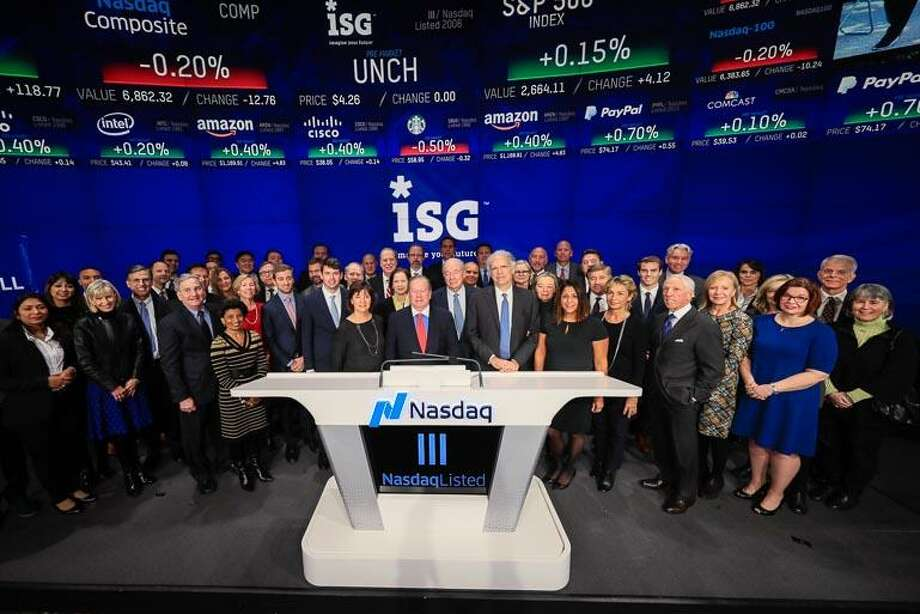 Information Services Group CEO and Chairman Michael Connors, center, rang the Nasdaq stock exchange's opening bell, in New York, N.Y., on Wednesday, Dec. 13, 2017, to mark the Stamford-based company's upcoming 10th anniversary as a Nasdaq-listed company. He was joined by ISG employees, family members, business associates and investors. Photo: Kelsey Ayres / / 2017 Kelsey Ayres / Nasdaq, Inc.
