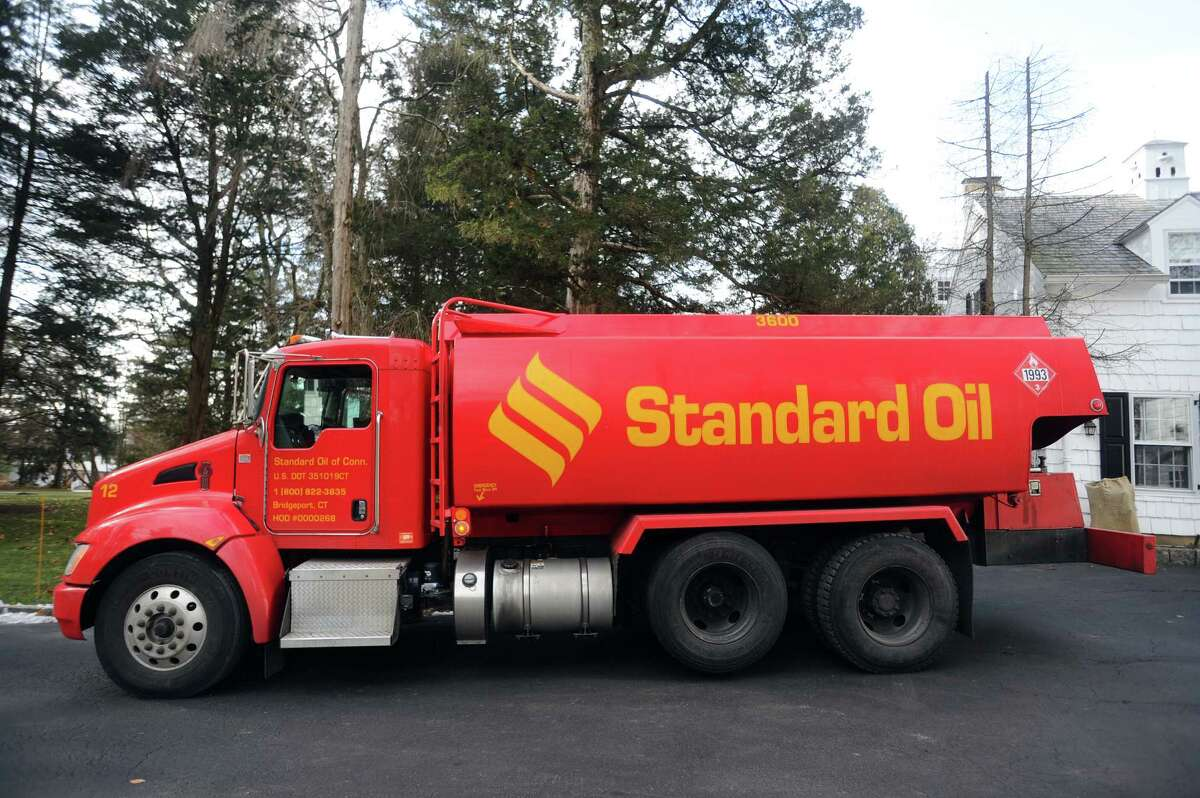 A Standard Oil truck is parked on a Dogwood Lane driveway while making a delivery in north Stamford, Conn., in this file photo.
