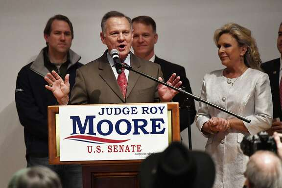U.S. Senate candidate Roy Moore speaks as his wife Kayla Moore looks on at the end of an election-night watch party at the RSA activity center, Tuesday, Dec. 12, 2017, in Montgomery, Ala. (AP Photo/Mike Stewart)