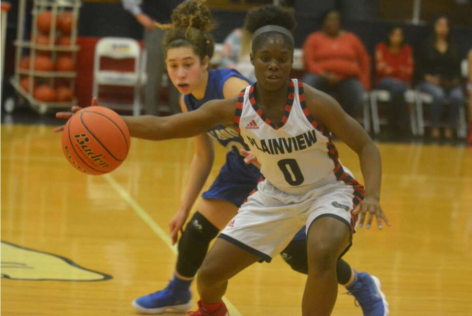 Plainview's Mahogany Nails spins away from a Palo Duro defender during the opening District 3-5A game of the season at the Plainview High School gym Tuesday night. Nails scored nine points and played solid defense to help the Lady Bulldogs to a 59-40 victory. Photo: Skip Leon/Plainview Herald