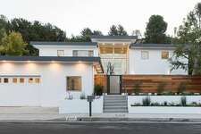 STREETVIEW - AFTER RENOVATION: Houston actor Dennis Quaid purchased this $3.9 million home in the Brentwood Hills area of Los Angeles after it underwent a major makeover.