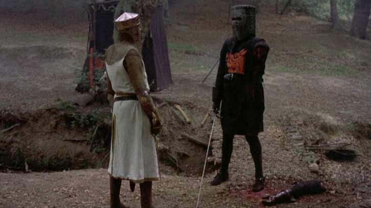 """King Arthur (Graham Chapman) and The Black Knight (John Cleese) spar in the 1975 film """"Monty Python and the Holy Grail,"""" which will screen before an appearnace by Cleese at the Majestic Theatre."""