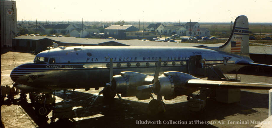 """A Pan American World Airways DC-4, the """"Clipper Union,"""" is parked at the Houston Municipal Airport in 1950. Pan Am rolled out its non-stop service from Houston to Mexico City, where this plane was headed, in December 1946. The airport from where this photo was taken is now the 1940 Air Terminal Museum. You can see more photos of the city's history in aviation at the Houston's Aviation History Facebook page. Photo: Bludworth Collection At The 1940 Air Terminal Museum"""