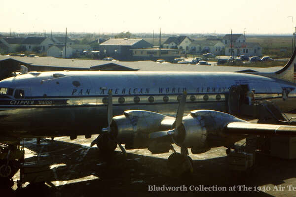 """A Pan American World Airways DC-4, the """"Clipper Union,"""" is parked at the Houston Municipal Airport in 1950. Pan Am rolled out its non-stop service from Houston to Mexico City, where this plane was headed, in December 1946. The airport from where this photo was taken is now the 1940 Air Terminal Museum. You can see more photos of the city's history in aviation at the  Houston's Aviation History Facebook page ."""