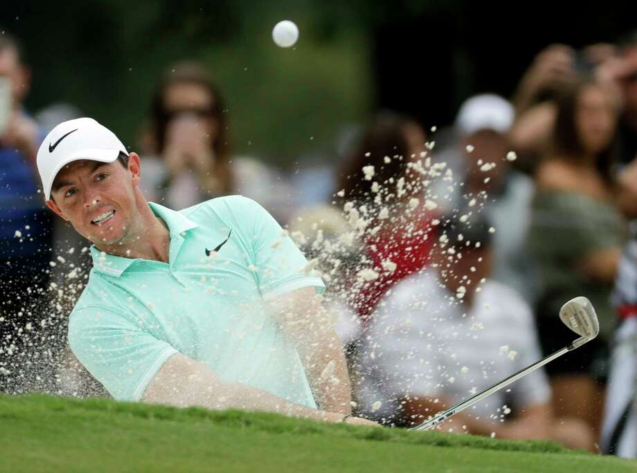 FILE - In this Aug. 9, 2017, file photo, Rory McIlroy of Northern Ireland, hits from the bunker on the ninth hole during a practice round at the PGA Championship golf tournament at the Quail Hollow Club, in Charlotte, N.C. McIlroy plans to play at least seven tournaments leading into the Masters next year. (AP Photo/Chris Carlson, File) Photo: Chris Carlson, STF / Copyright 2017 The Associated Press. All rights reserved.