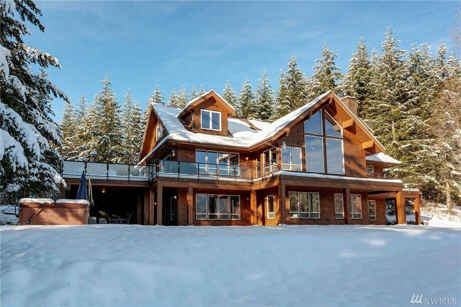 This home at 8174 Mt. Baker Hwy is listed for $995,000. It has seven bedrooms, 7½ bathrooms and spans more than 6,600 square feet.The custom-built home sits on 40 acres and include three fireplaces and a patio with a hot tub. Photo: Photos By Jake Knapp, C9/listing Courtesy Chet Kenoyer, Windermere Real Estate Whatcom
