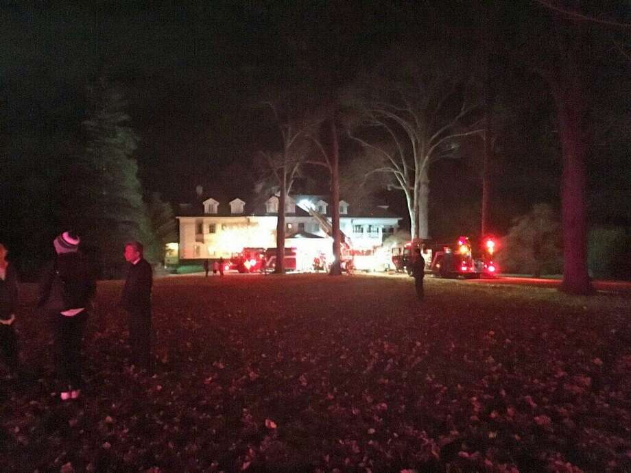 Fire crews respond to Field Point Circle on the night of Dec. 7. A fire broke out there during a fundraiser for Republican gubernatorial candidate Steve Obsitnik. Photo: Contributed Photo