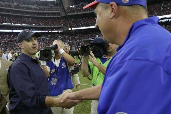Houston Texans head coach Bill O'Brien, left, shakes hand with Buffalo Bills head coach Doug Marrone, right, following an NFL football game, Sunday, Sept. 28, 2014, in Houston. (AP Photo/David J. Phillip)