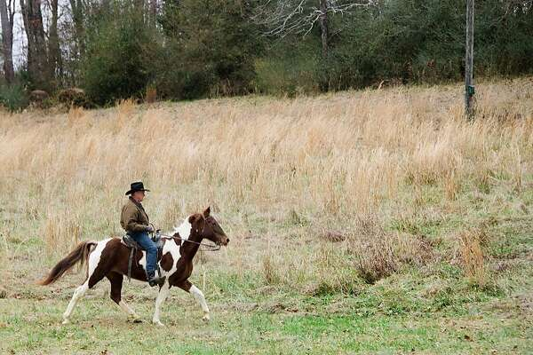TOPSHOT - Republican Senatorial candidate Roy Moore rides his horse, Sassy, to the polling station to vote in  Gallant, Alabama, on December 12, 2017. The state of Alabama holds a closely-watched special election for US Senate featuring Republican candidate Roy Moore, who is endorsed by President Donald Trump despite being accused of molesting teenaged girls. / AFP PHOTO / JIM WATSONJIM WATSON/AFP/Getty Images