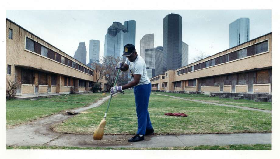PHOTOS: Houston in 1988  Craig Bolden, a Houston Housing Authority employee, sweeps grass trimmings amid boarded-up buildings at Allen Parkway Village in February 1988.  >>>See more photos of Houston in 1988... Photo: John Everett/Houston Chronicle