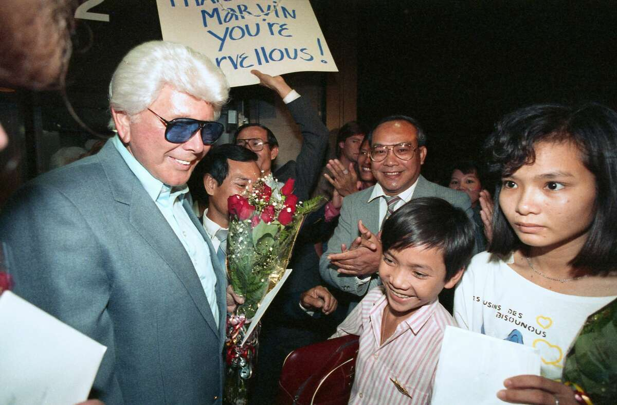 """Marvin Zindler was a """"champion of Houston."""" Here, Zindler helps welcome Hoang Nguyen, 13, bottom right, to Houston. Zindler traveled to Vietnam to bring Nguyen and his sister, Kim, 16, at right, to Houston to be reunited with their father, Son Van Nguyen. The family was separated 13 years ago by the Vietnam War. Zindler's efforts then resulted in the U.S. State Department negotiating a program where 2,000 Vietnamese will be released monthly to their families in this country."""