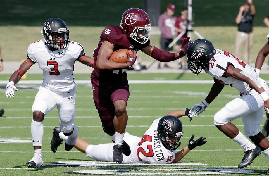 Cy-Fair's Trenton Kennedy (43) pushes through the hole between Langham Creek's Golden Eke (3), Brad Pinkerton and Corien Azema during the first half of their game Saturday, Nov. 11, 2017, in Houston, TX. (Michael Wyke / For the  Chronicle) Photo: Michael Wyke, Freelance / © 2017 Houston Chronicle